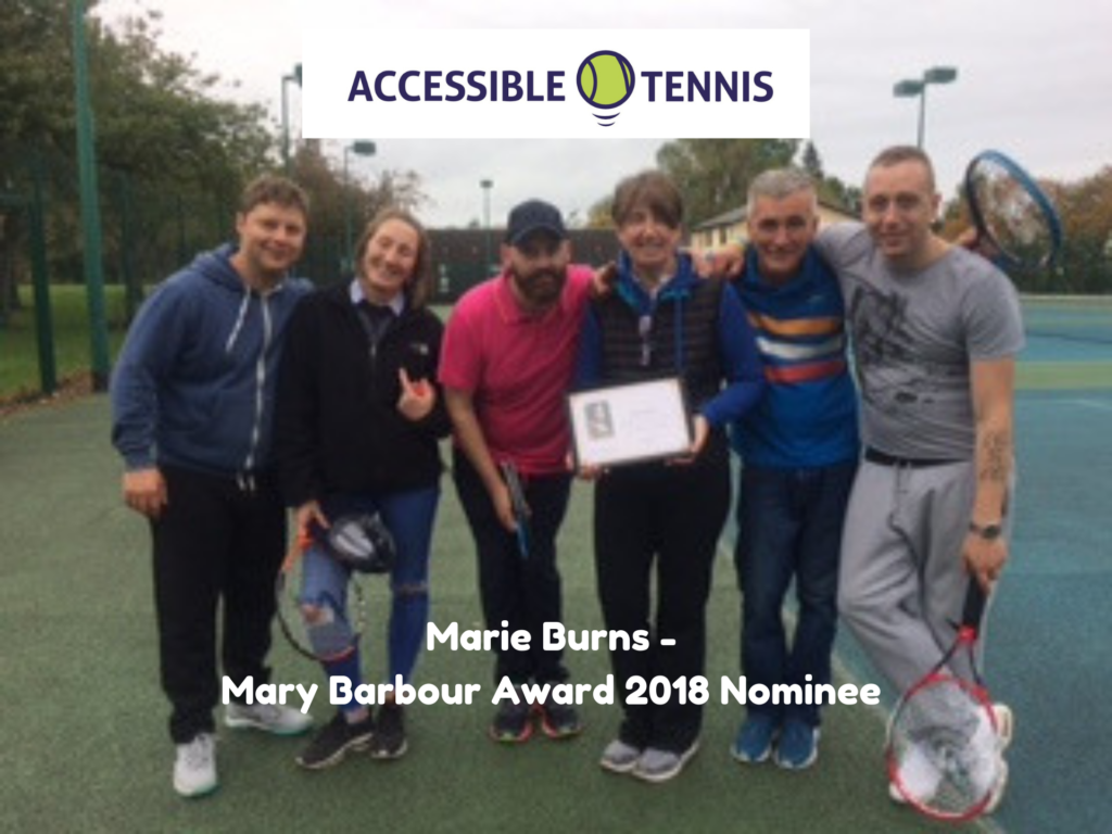 Marie Burns holding a certificate along with a group of tennis players